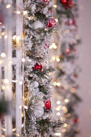 Christmas decorated wall with bokeh on the background.