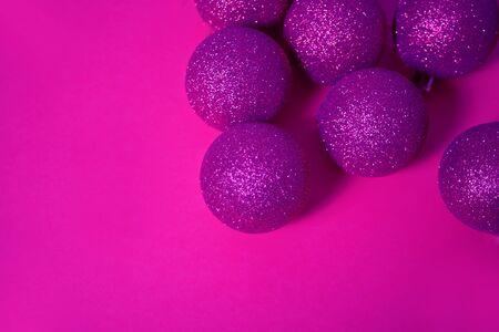Christmas sparkle balls in a purple color. Copy space Imagens