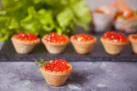 Fresh red caviar in tartlets. Delicatessen and gourmet food.