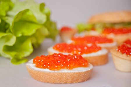 Fresh red caviar on bread. Sandwiches with red caviar.Delicatessen. Gourmet food. Stock fotó