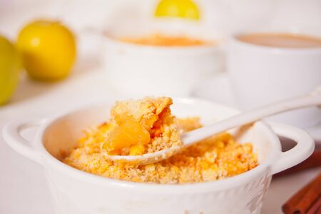 Tasty homemade apple crumble dessert on the white background 版權商用圖片