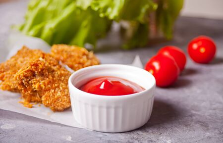 Fried crispy chicken nuggets with ketchup Stockfoto