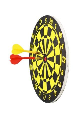 holed: yellow dart board isolated Stock Photo