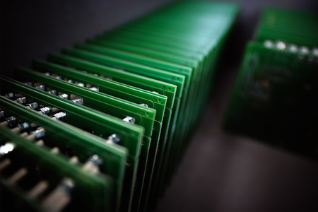 Electronic components assembly hall at high-tech factory blur background with bokeh