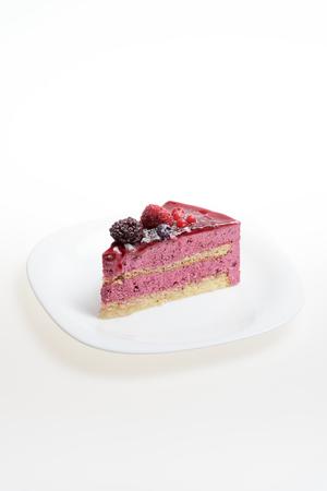 Slice of delicious healthy cake white background 版權商用圖片