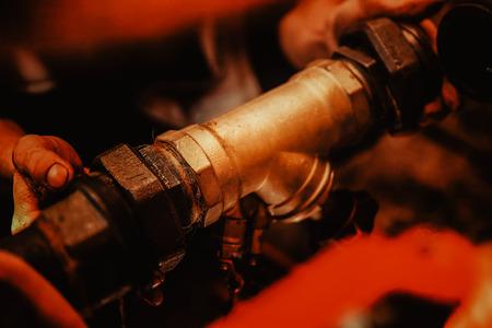 Heating engineer repairing and maintaining heating system