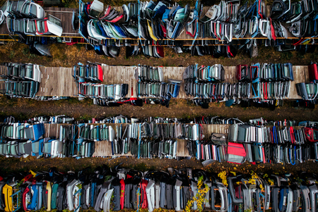 Damaged cars waiting in a scrapyard to be recycled or used for spare part 新聞圖片