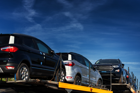 Vehicles loaded and ready for delivery for dealership