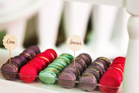 Colorful macaroons stacked on display at an event
