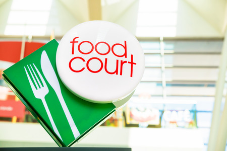 Food court sign with green and red Stock Photo