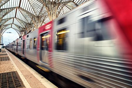 Blurry train going fast through Lisbon portugal Oriente Train Station