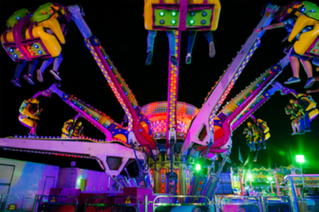 Blurred Amusement park ride at night conceptual image of entertainment & fun