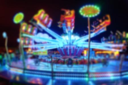 Blurred Amusement park ride at night conceptual image of entertainment & fun