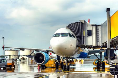 Passenger plane under pouring rain