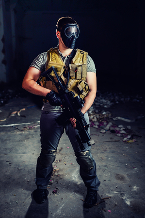 man in military uniform holding a gun