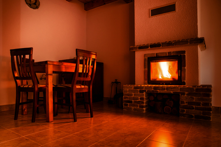 Fire place in rustic decorated room warm and rustic