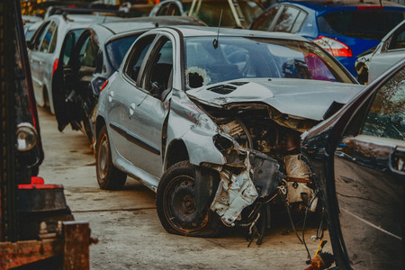 Damaged cars waiting in a scrapyard to be recycled or used for spare part Reklamní fotografie