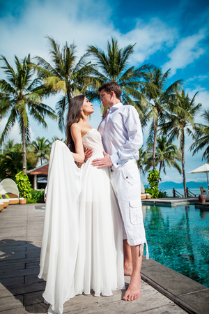 Newly married couple after wedding in luxury resort. Romantic bride and groom.