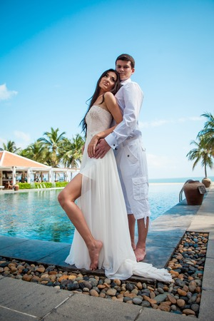 Newly married couple after wedding in luxury resort. Honeymoon.