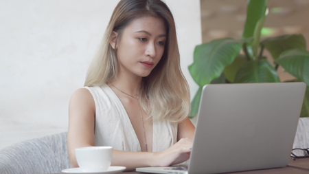 Professional woman working on laptop computer
