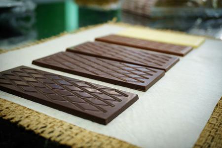Bars of white, dark, bitter an milk chocolate