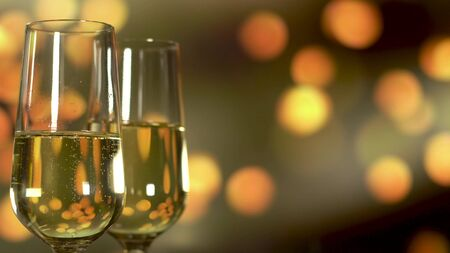 Two glasses of champagne with bubbles on golden blinking background.