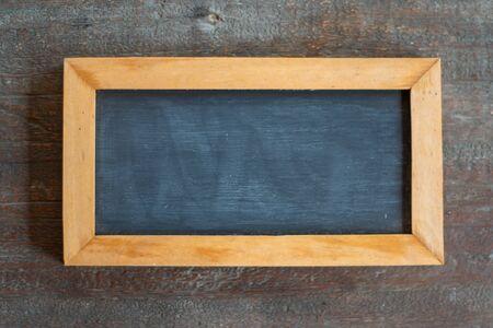 Empty chalk board on wooden background. Blank blackboard with wooden frame.