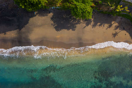 Aerial shot of the tropical bay with sandy beach. Amed, Bali, Indonesia