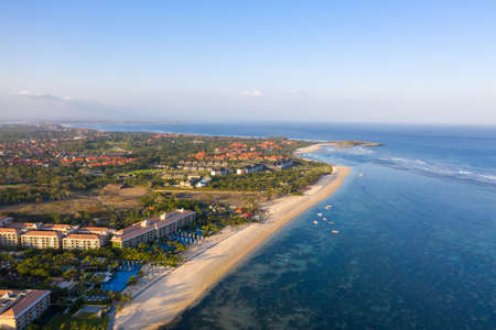 Aerial view of beautiful beach, hotels, Nusa Dua Bali, Indonesia. Travel concept Фото со стока
