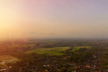 Sunrise landscape on the Bali island. View of mounts, Ubud village, rice fields.