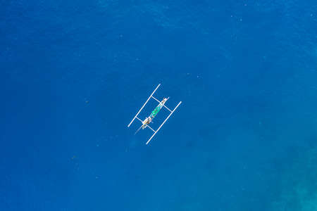 Aerial view of traditional Indonesian fishing boat in the ocean
