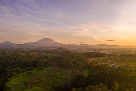 Sunrise landscape on Bali island. View of mountains, Ubud village, rice fields. Фото со стока