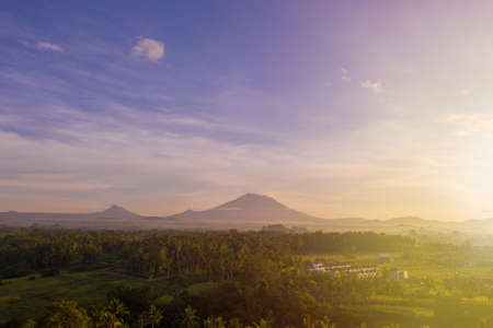 Sunrise landscape on island of Bali. View of mountains, Ubud village and rice fields.
