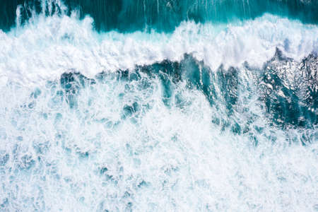 Aerial view to ocean waves. Blue water background Фото со стока