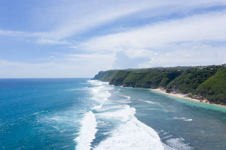 Aerial drone image of Melasti Beach shore. Bali. Фото со стока
