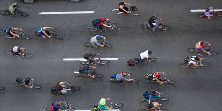 road bike: Bikers travelling through the city to make an environmental friendly statement, shot from above.