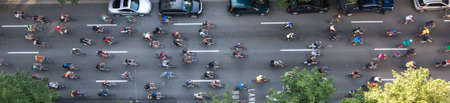 viewpoints: Bikers travelling through the city to make an environmental friendly statement, shot from above.