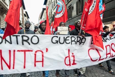 Florence, Italy - March 12, 2016: A march of immigrants in the streets of downtown, against war, demanding work and freedom.