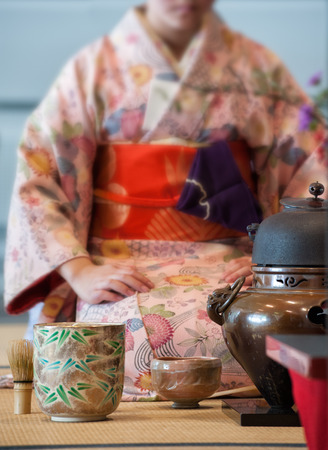 tact: a japanese woman shows the tea ceremony during a public demonstration