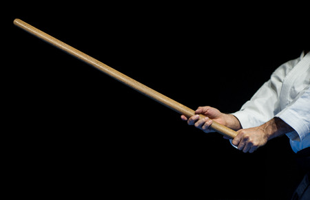 aikido fighter with his wood stick during a public fight demonstration Stock Photo