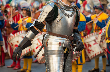 The inspection of the Medieval knight in body armor, during historical reenactment in Florence