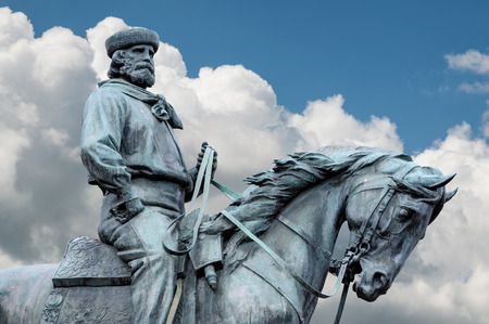 Giuseppe Garibaldi, the Hero of Two Worlds, equestrian statue with blue sky and clouds on background Stock Photo