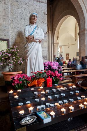Mother Teresa of Calcutta votive statue worship