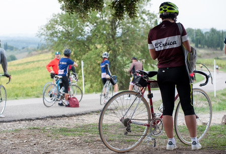 Gaiole in Chianti, Tuscany, Italy - October 1, 2017: Unidentified participant of LEroica, a historic cycling event for owners of vintage bicycles, played on white gravel roads of Chianti Editorial