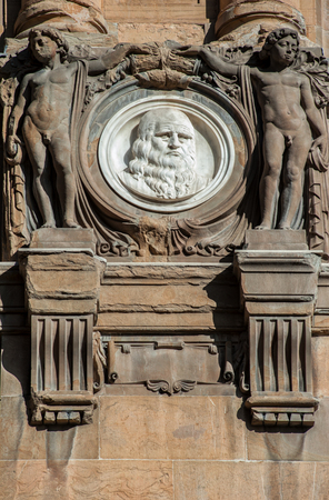 Italy, Tuscany, Florence - October 23, 2017: Leonardo Da Vinci, by Olinto Calastri (1920), portrait medallion on the National Central Library facade.