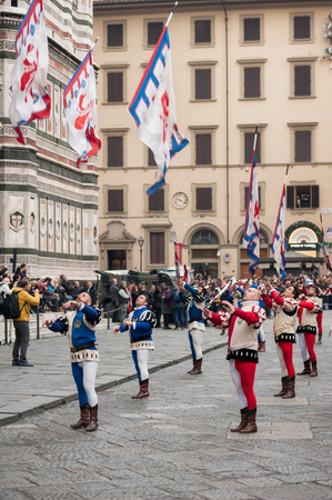 Florence, Tuscany, Italy - January 6, 2018: Flying flags performance, in front of the Cathedral of Santa Maria del Fiore, during the historical recreation of the Procession of the Magi.