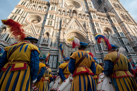 Florence, Tuscany, Italy - January 6, 2018: Extras with drums and costumes in front of the facade of Santa Maria del Fiore, during the historical recreation of the Procession of the Magi