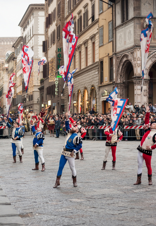 Florence, Tuscany, Italy - January 6, 2018: Flying flags performance, in front of the Cathedral of Santa Maria del Fiore, during the historical recreation of the Редакционное