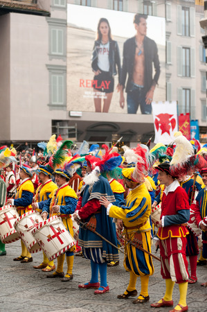 Florence, Tuscany, Italy - January 6, 2018: Extras with Renaissance flashy clothes, in multiple rows, on the churchyard of Santa Maria del Fiore, during the historical recreation of the