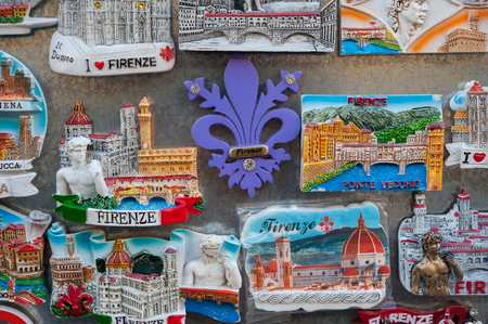 Tourist magnet souvenirs on sale at the market stall in Florence, Italy Stock Photo